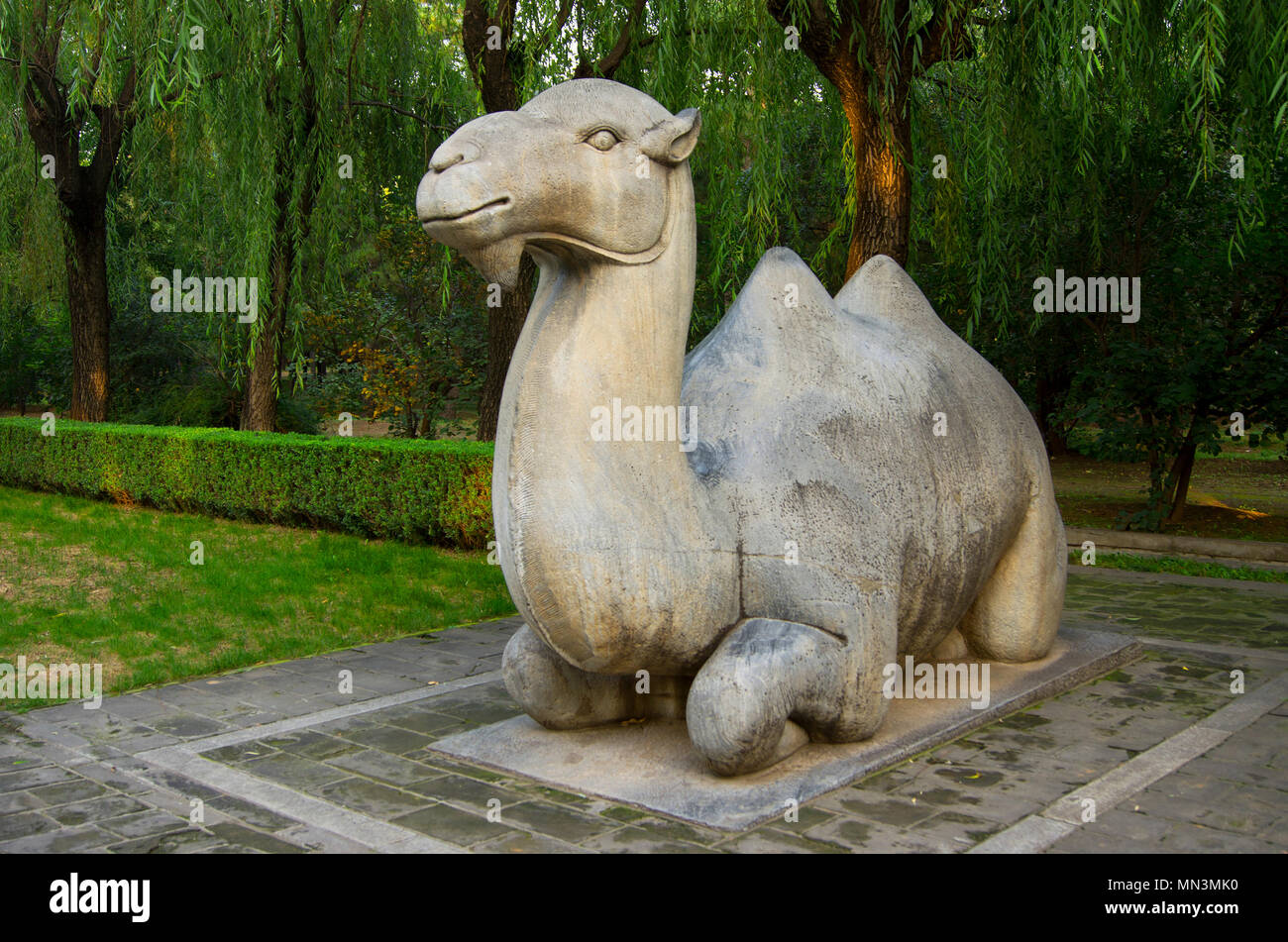A stylised stone-carved Chinese camel in a park near the Ming Tombs, northwest of Beijing, China. - Stock Image