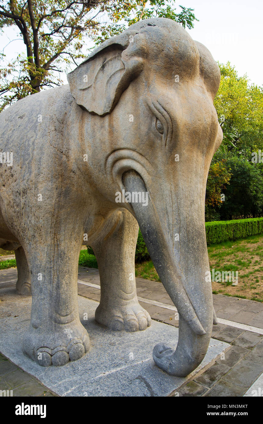 A stylised stone-carved Chinese elephant in a park near the Ming Tombs, northwest of Beijing, China. - Stock Image
