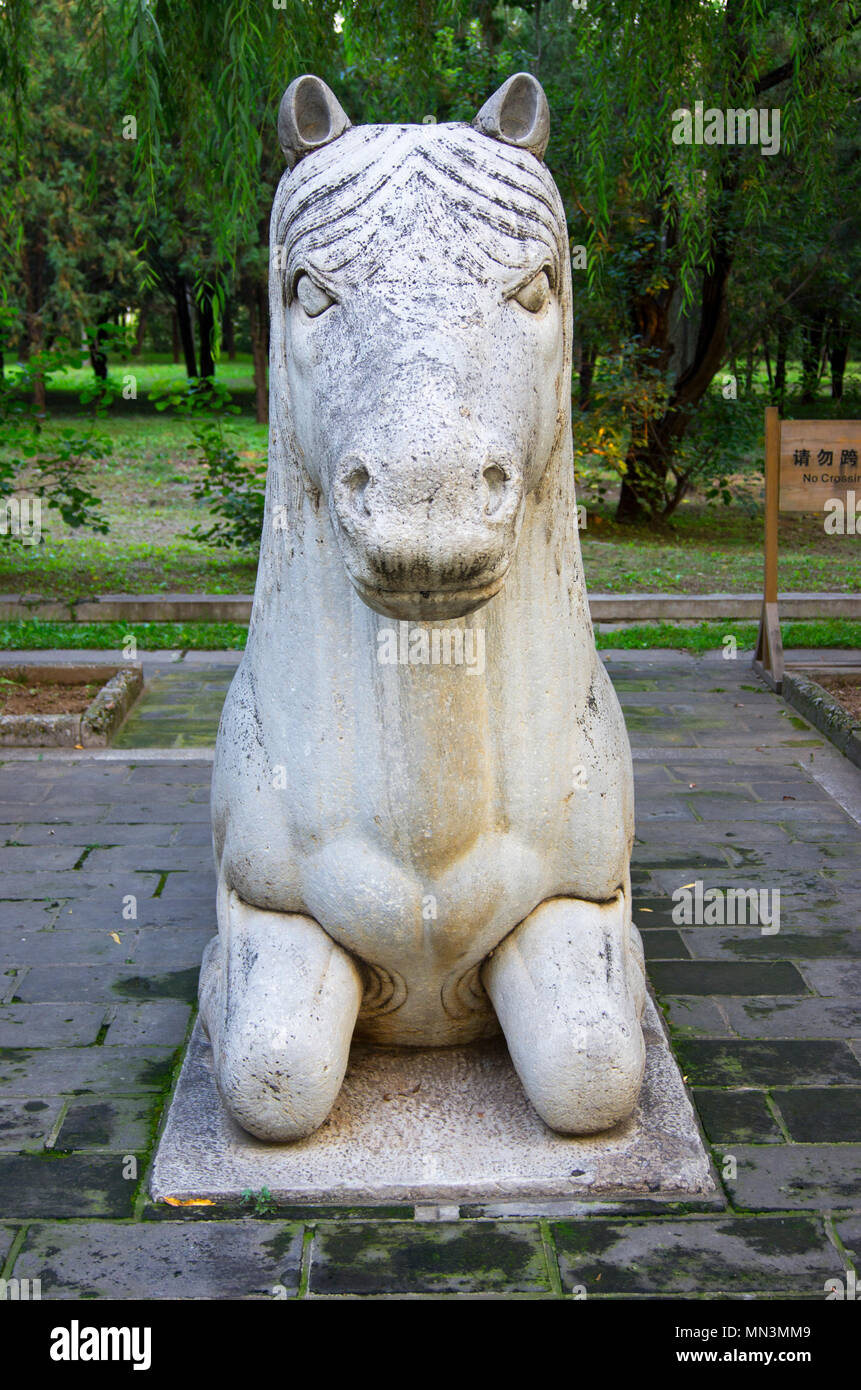 A stylised stone-carved Chinese horse in a park near the Ming Tombs, northwest of Beijing, China. - Stock Image