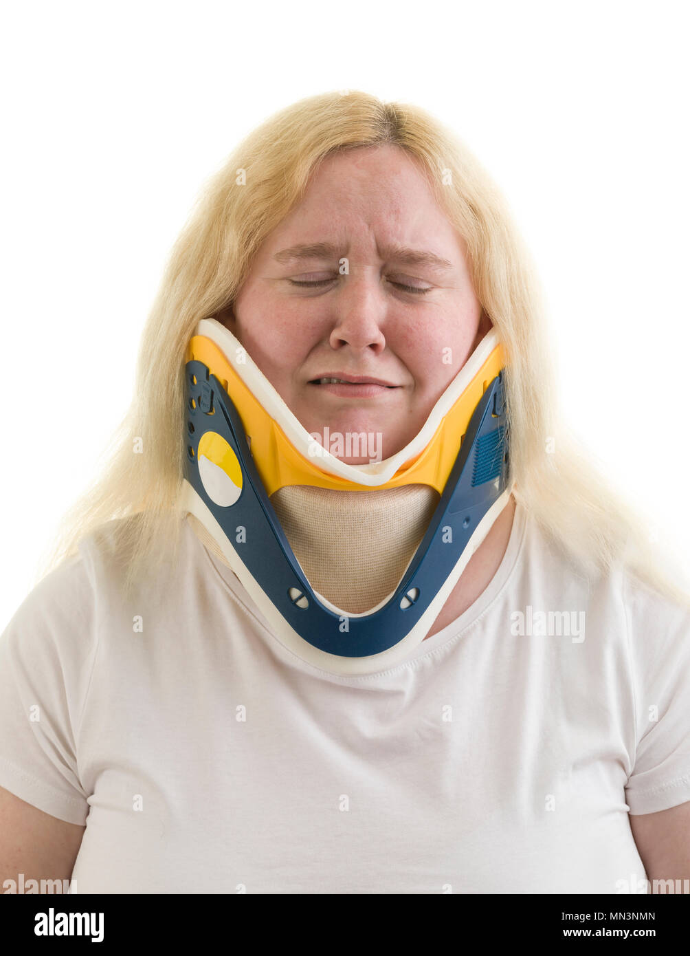 Caucasian blonde adult 30s female woman wearing a cervical collar aka a C spine collar or neck brace isolated on white background  Model Release: Yes. Property Release: No. - Stock Image