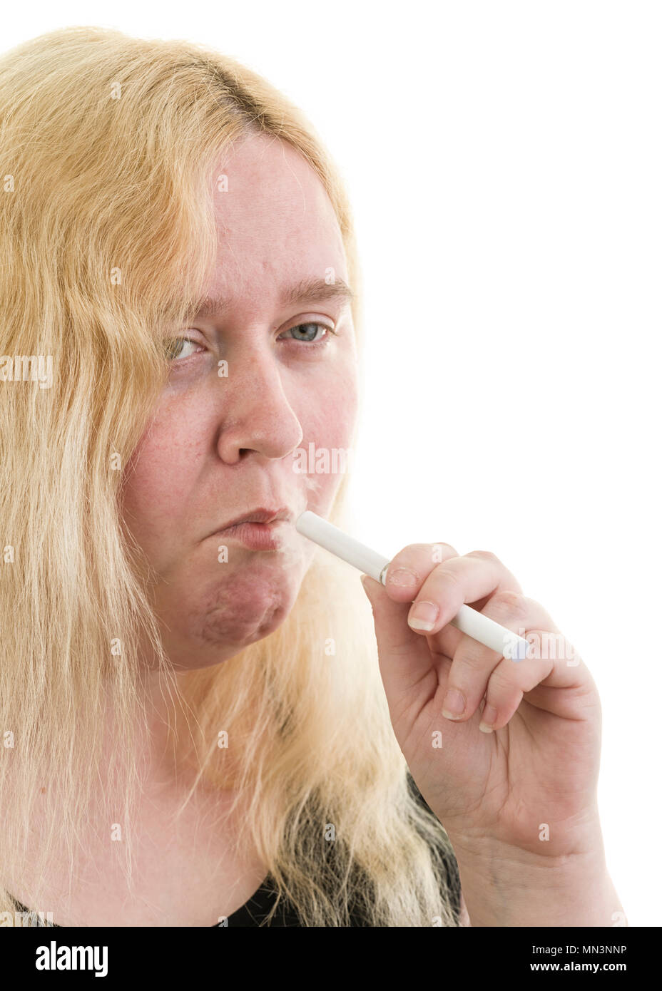 Young caucasian blonde female woman using smoking an electronic cigarette isolated on white background  Model Release: Yes. Property Release: No. - Stock Image