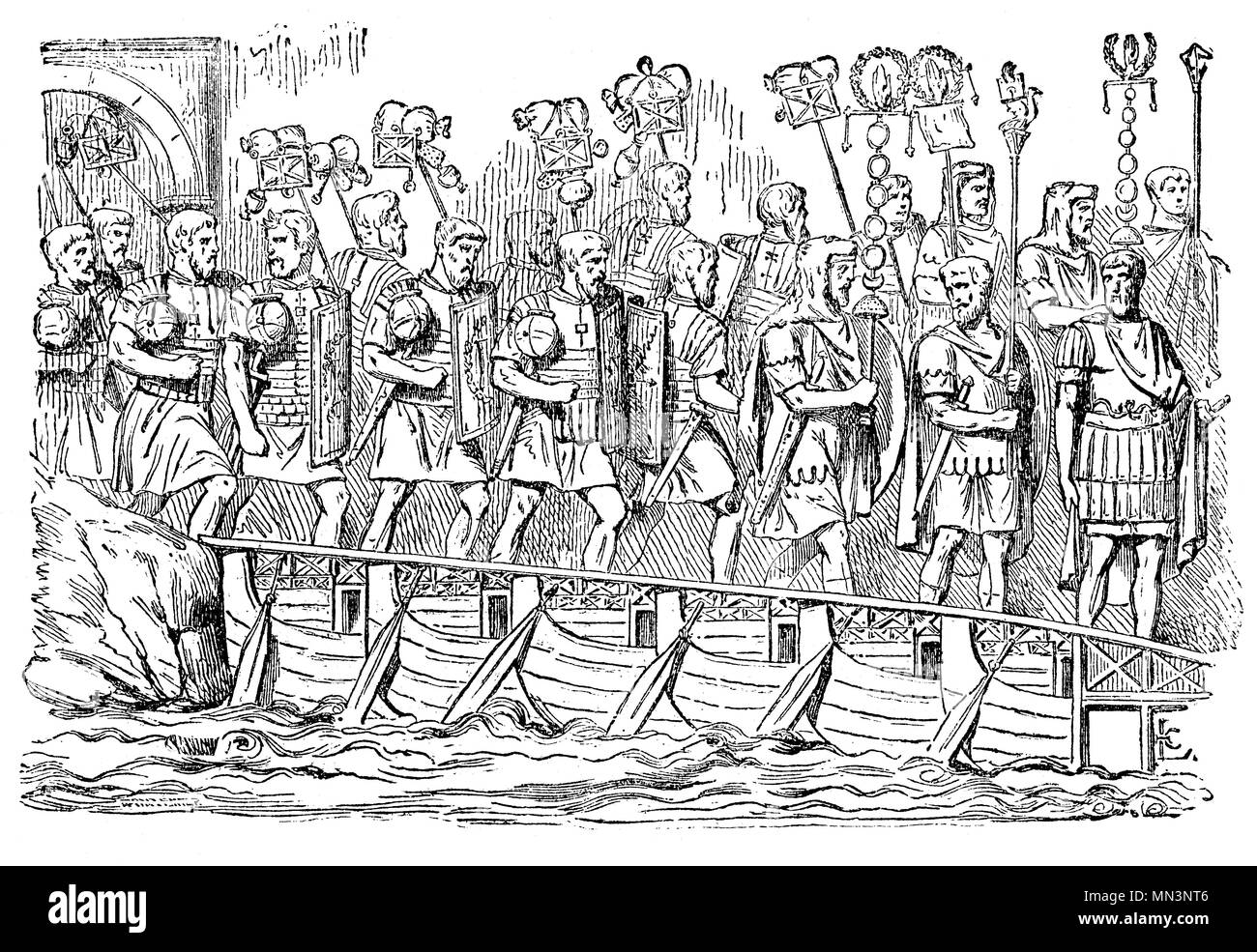Invading Roman soldiers passing over a bridge of boats. It consisted of a number of the small boats hollowed out of one piece of timber and very light both by their make and the quality of the wood. The army always has a number of these boats upon carriages, together with a sufficient quantity of planks and iron nails. Thus with the help of cables to lash the boats together, a bridge is instantly constructed, which for the time has the solidity of a bridge of stone. - Stock Image
