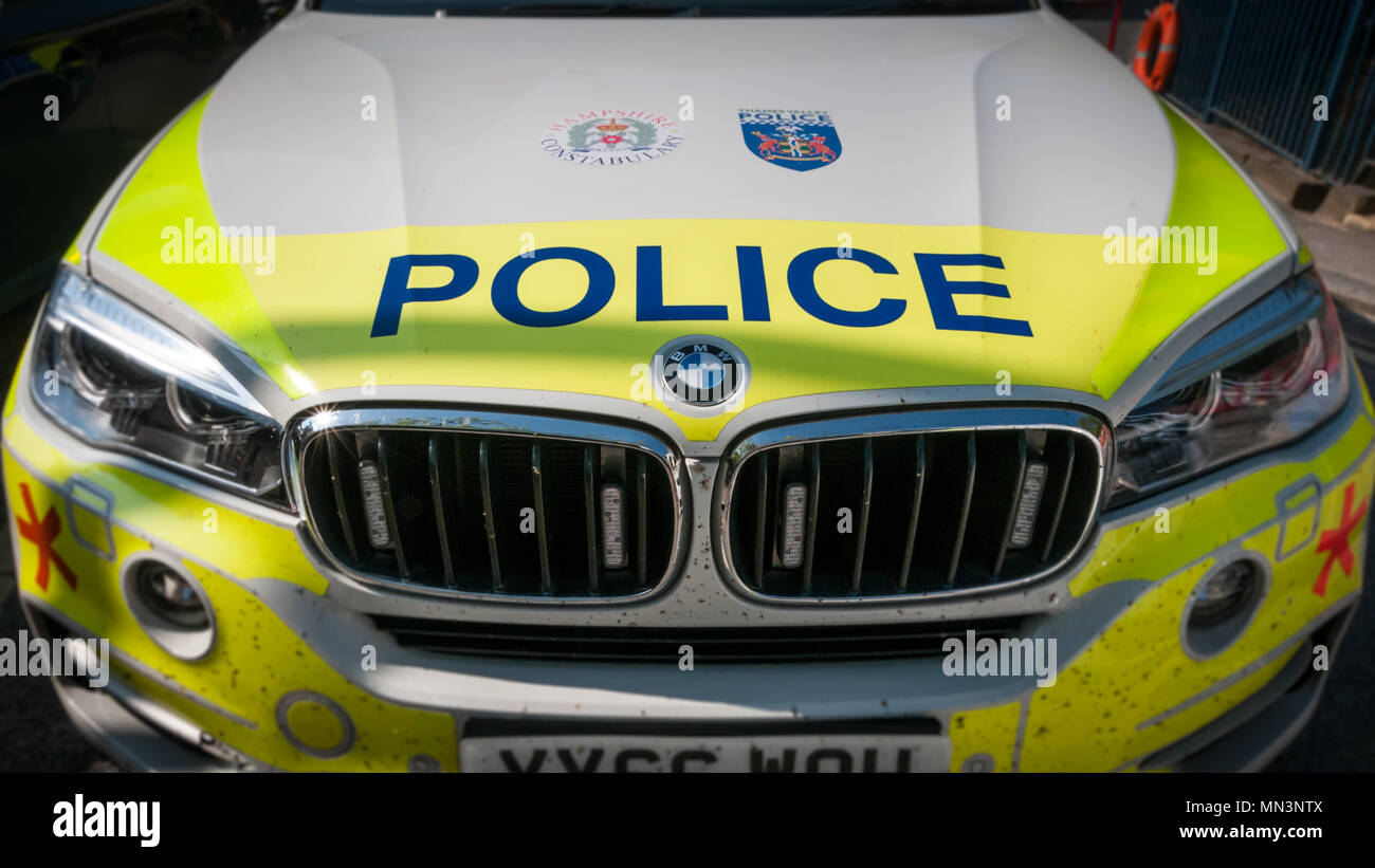 Front view of a BMW UK police car bonnet and dirty grill Stock Photo