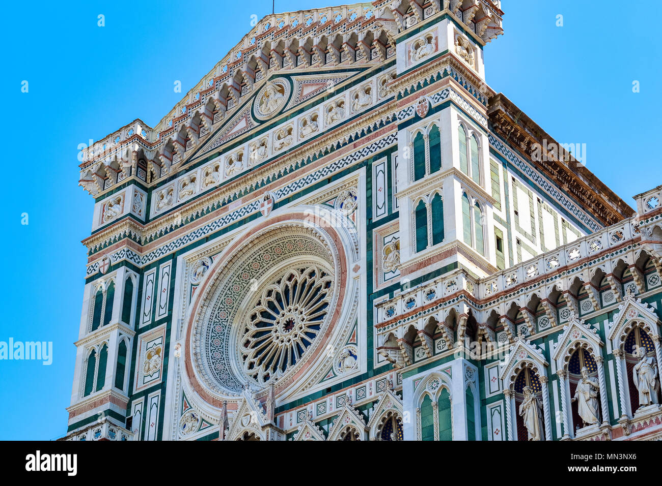 Facade of the Cattedrale di Santa Maria del Fiore (Cathedral of Saint Mary of the Flower) in Florence, Italy against a cloudless sky - Stock Image