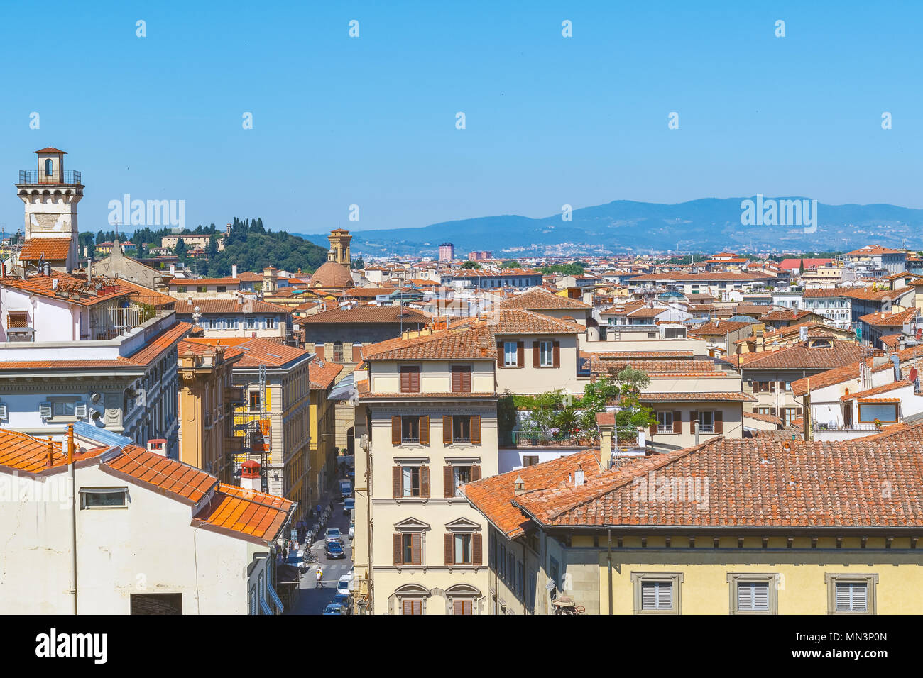Cityscape of Florence in Italy, featuring red terracotta roofs - Stock Image