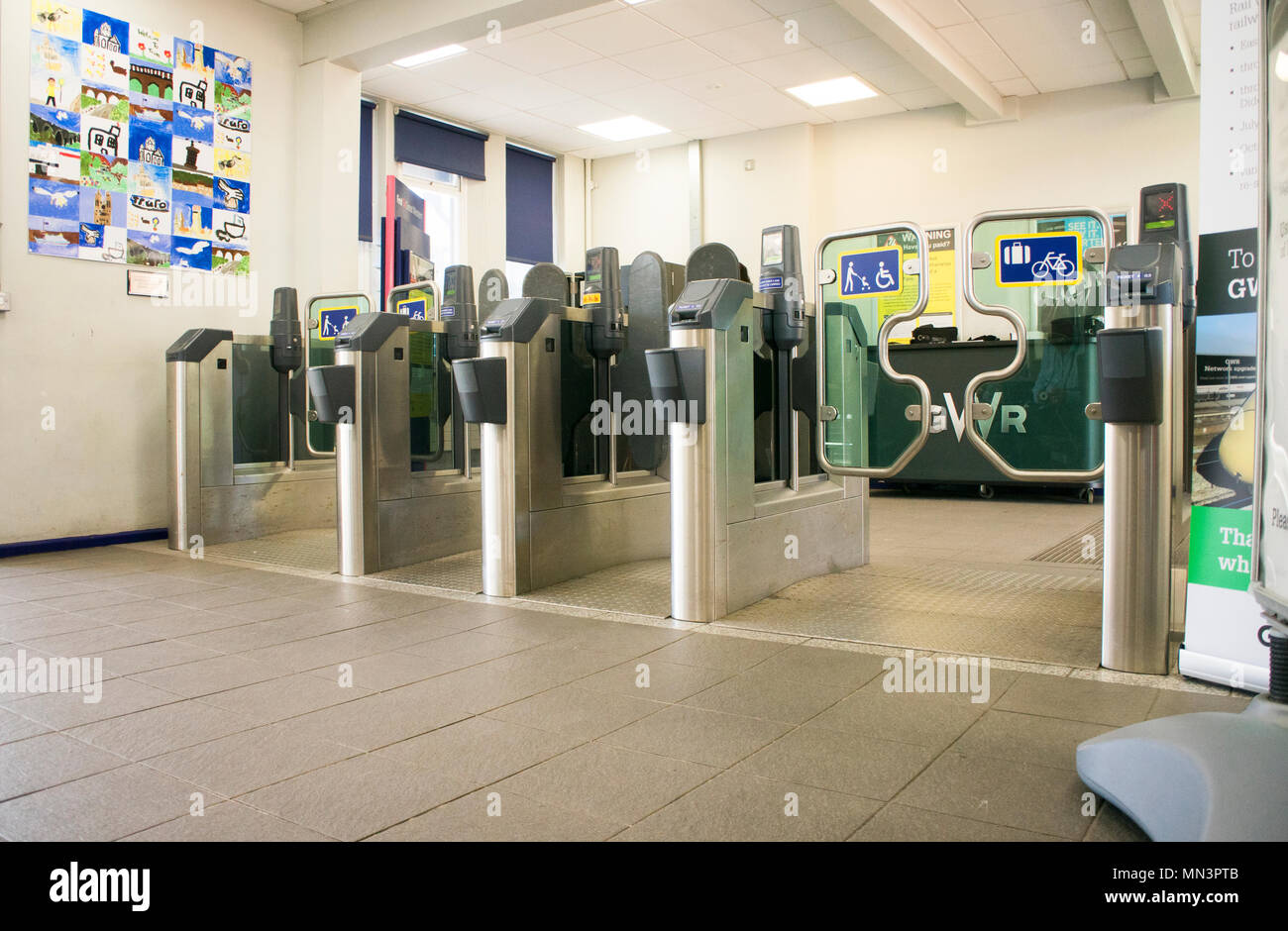 Ticket barriers at an English railway station - John Gollop - Stock Image