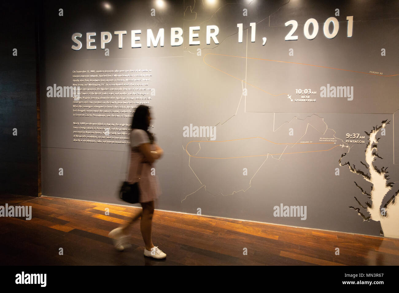 A woman visitor at the 11 September Memorial and Museum, downtown New York, New York city, USA - Stock Image