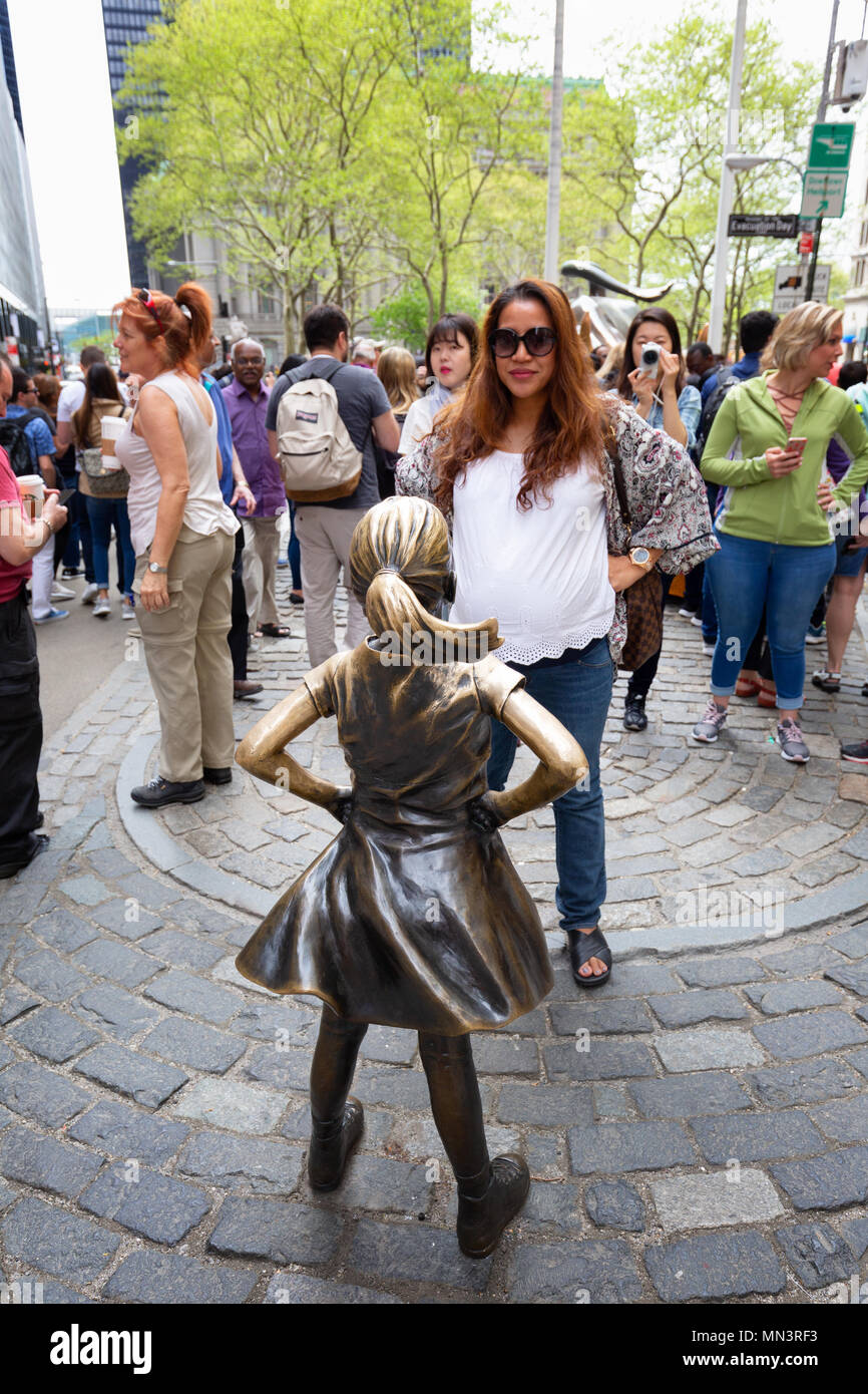 Tourists surrounding The Fearless Girl statue by Kristen Visbal, downtown New York, New York City, United States of - Stock Image