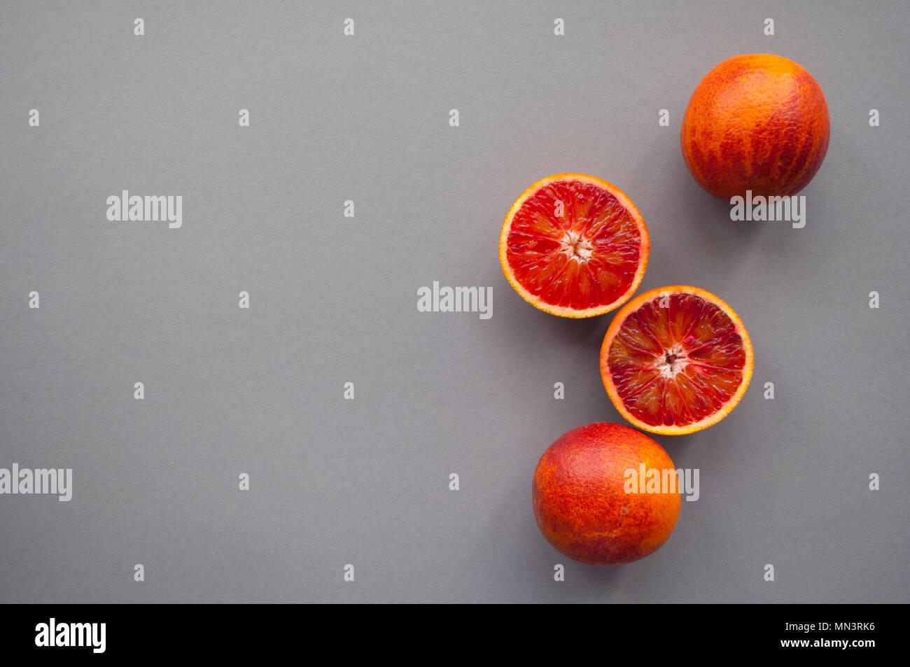 Blood orange on purple background. - Stock Image