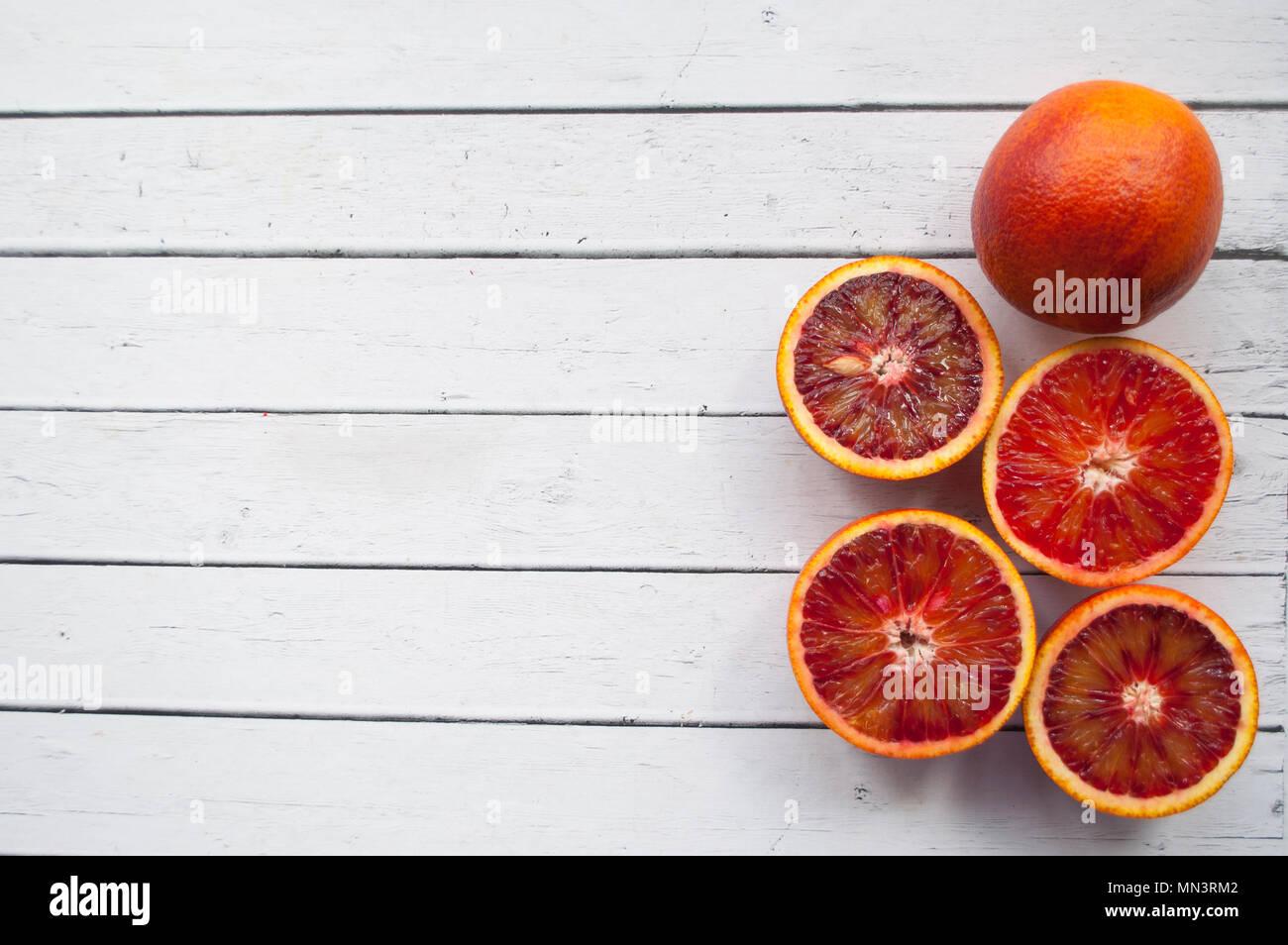 Blood orange on white table. Stock Photo