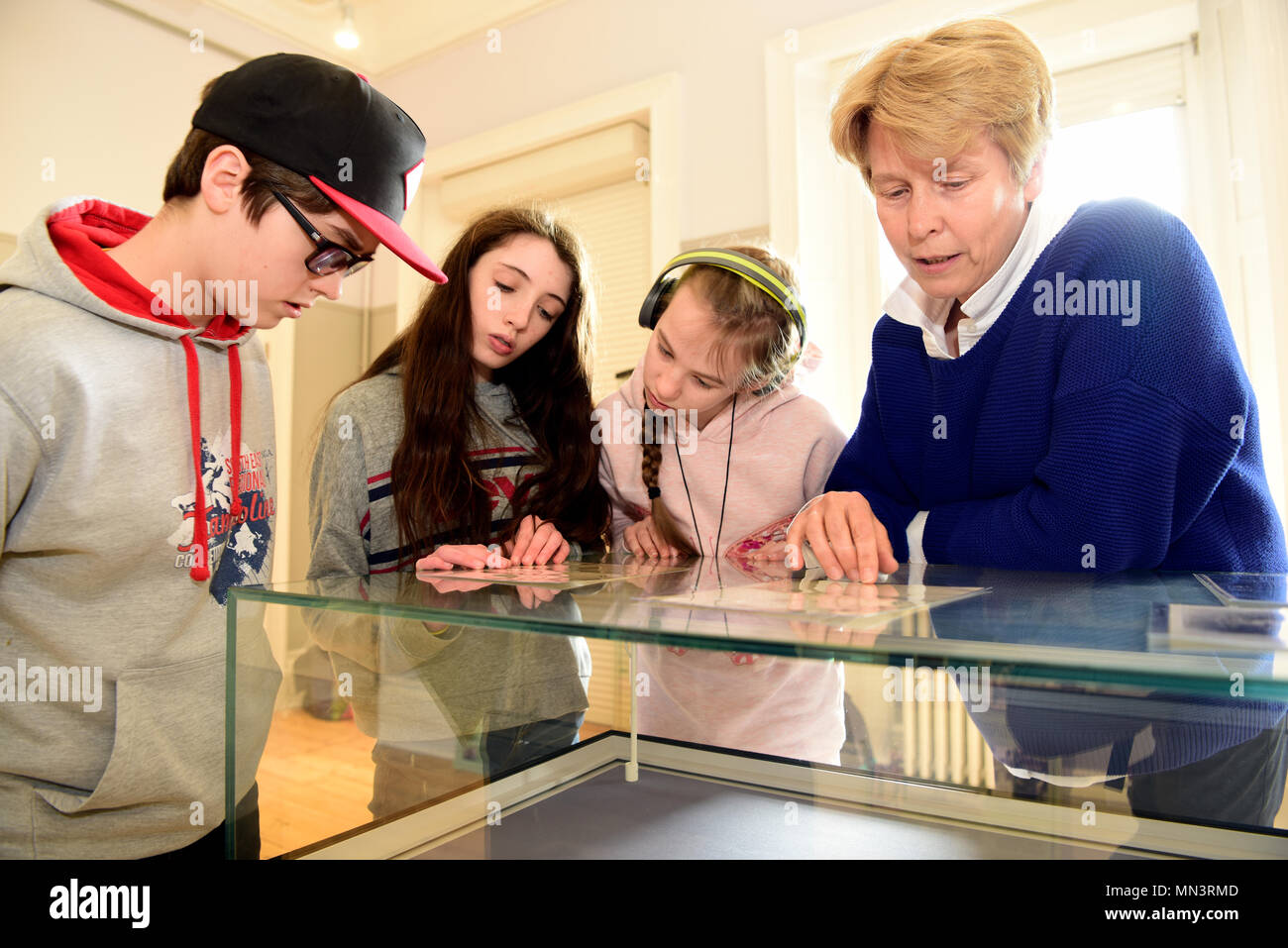 Local schoolchildren & museum official browsing memorabilia about literary icon Sir Arthur Conan Doyle (born 22 May 1859-died 7 July 1930)... - Stock Image