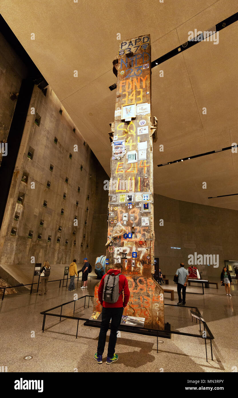 A visitor looking at The Last Column from Ground Zero, National September 11 Memorial & Museum, downtown New York, New York City, USA - Stock Image