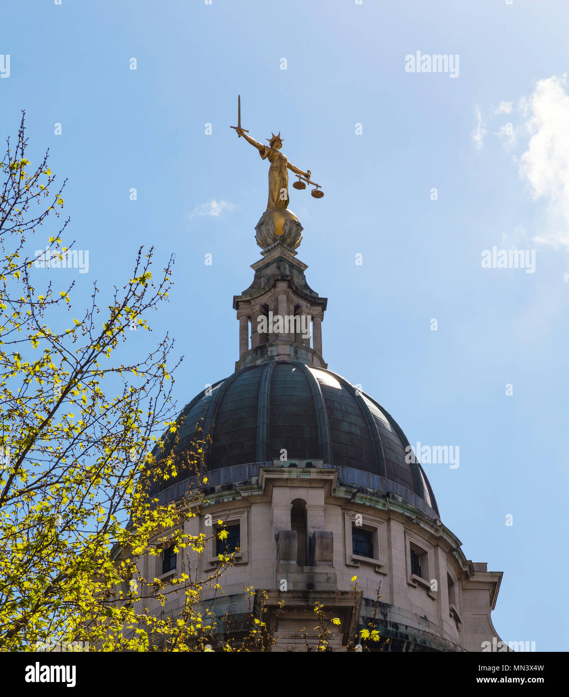 Lady Justice statue on the top of the Old Bailey court building - Stock Image