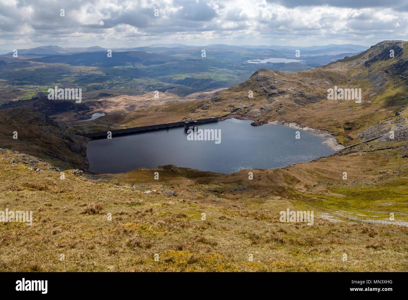 Llyn Stwlan the upper reservoir of the Ffestiniog Hydro electric pump storage station sitting near the summits of Moelwyn Mawr and Moelwyn Bach - Stock Image