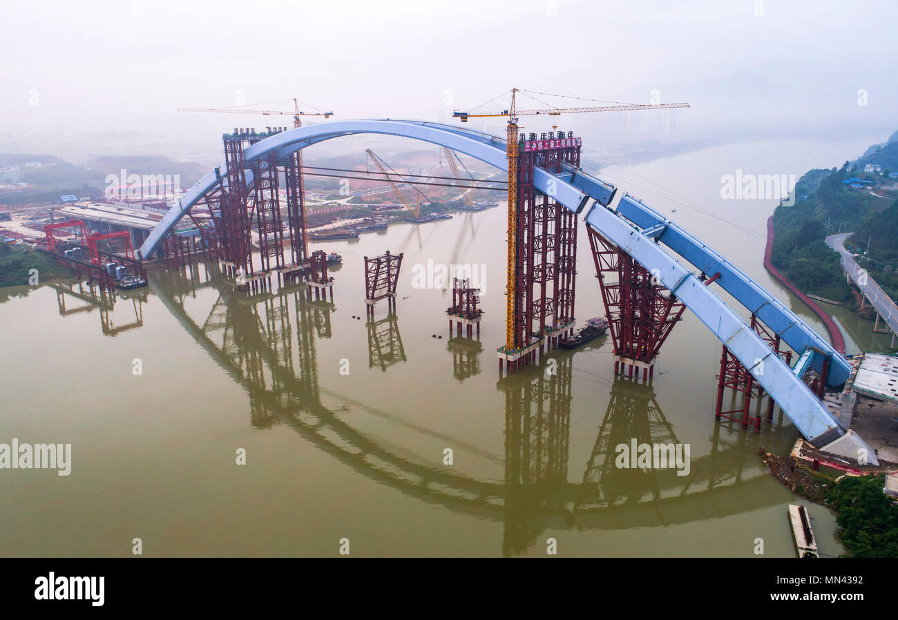 (180514) -- LIUZHOU, May 14, 2018 (Xinhua) -- Aerial photo taken on May 14, 2018 shows the Liuzhou Guantang Bridge in south China's Guangxi Zhuang Autonomous Region. The middle bridge arch, weighing 5,885 metric tons, was successfully hoisted to its installation position on Monday. (Xinhua/Li Bin) (zyd) - Stock Image