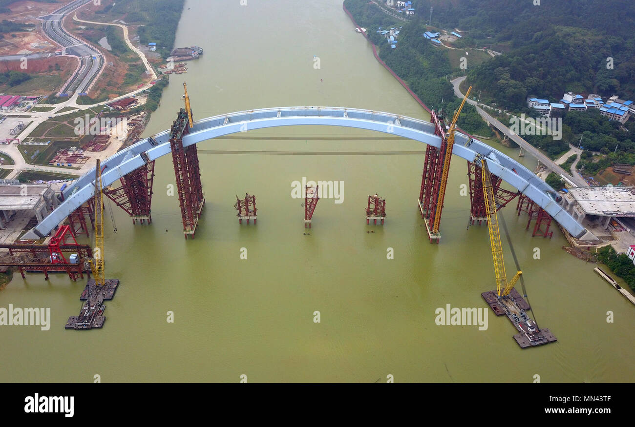 Liuzhou. 14th May, 2018. Aerial photo taken on May 14, 2018 shows the Liuzhou Guantang Bridge in south China's Guangxi Zhuang Autonomous Region. The middle bridge arch, weighing 5,885 metric tons, was successfully hoisted to its installation position on Monday. Credit: Li Hanchi/Xinhua/Alamy Live News - Stock Image