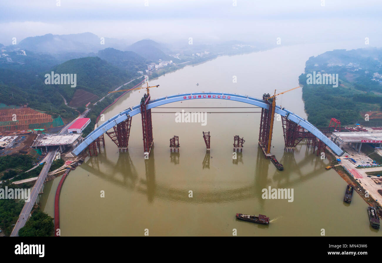 Liuzhou. 14th May, 2018. Aerial photo taken on May 14, 2018 shows the Liuzhou Guantang Bridge in south China's Guangxi Zhuang Autonomous Region. The middle bridge arch, weighing 5,885 metric tons, was successfully hoisted to its installation position on Monday. Credit: Li Bin/Xinhua/Alamy Live News - Stock Image