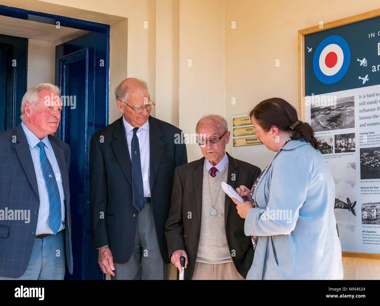 Drem, Scotland, 14 May 2018. Celebrating RAF Drem centenary, Scotland, UK. A plaque unveiled to mark the 100th anniversary. It played an important role in World War II, with  43rd Squadron stationed here. Gordon Mills, aged 96, who was stationed here during World War II unveiled the information board. The airfield is famed for inventing the Drem lighting system, aiding spitfires to land at night, which was adopted by all RAF stations. Remaining buildings are now Fenton Barns retail village. The war veteran being interviewed by the local paper, the East Lothian Courier - Stock Image