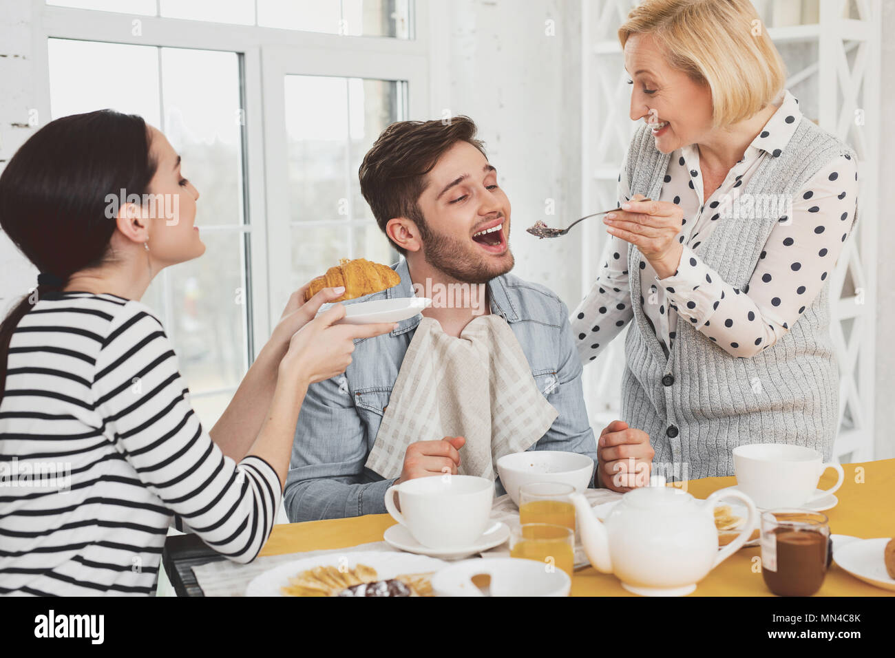 Happy young man opening his mouth - Stock Image