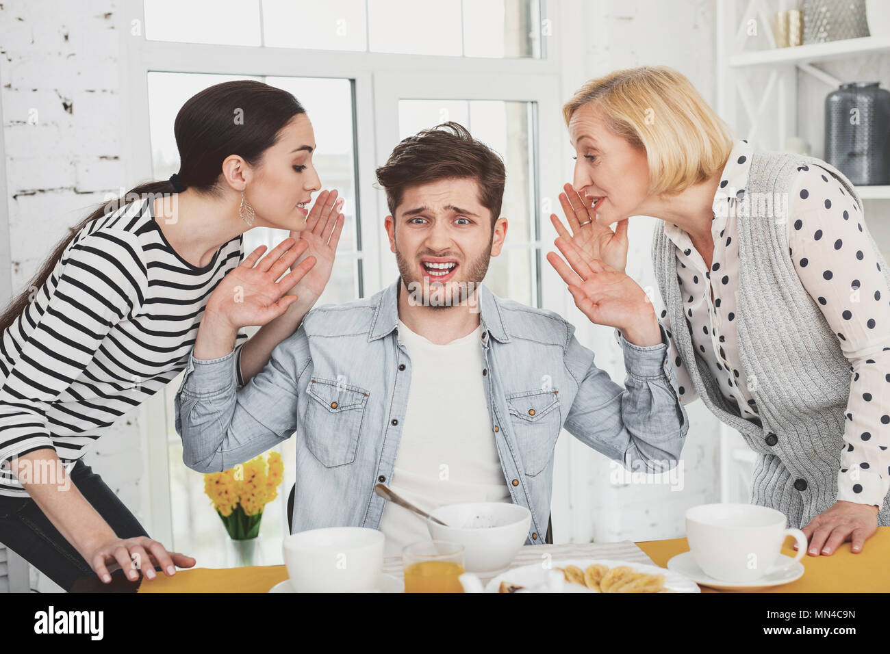 Cheerless unhappy man feeling stressed out - Stock Image