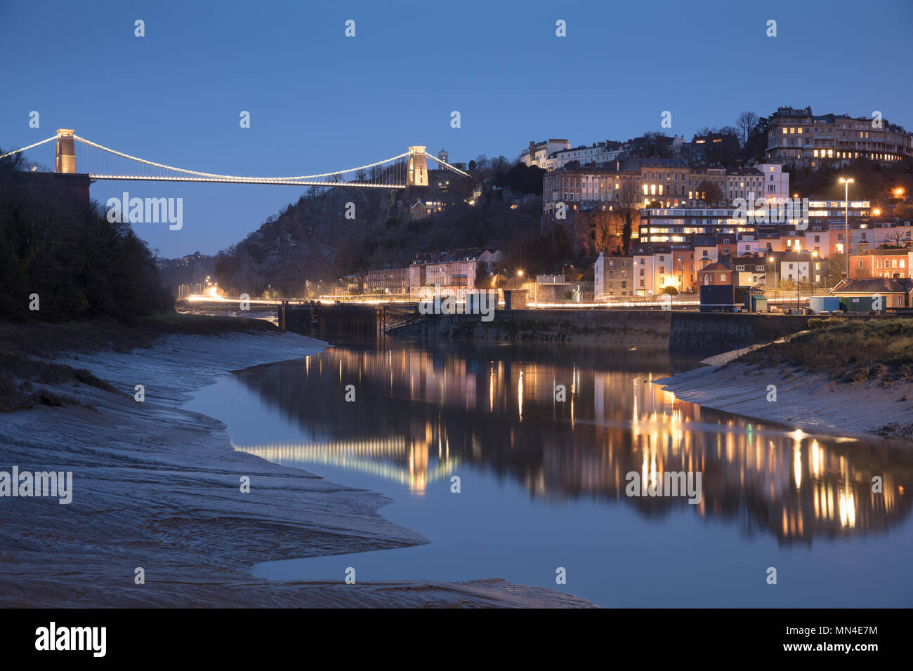 The Avon River, Hotwells and Clifton Suspension Bridge over the Avon Gorge at dusk, Bristol, England Stock Photo