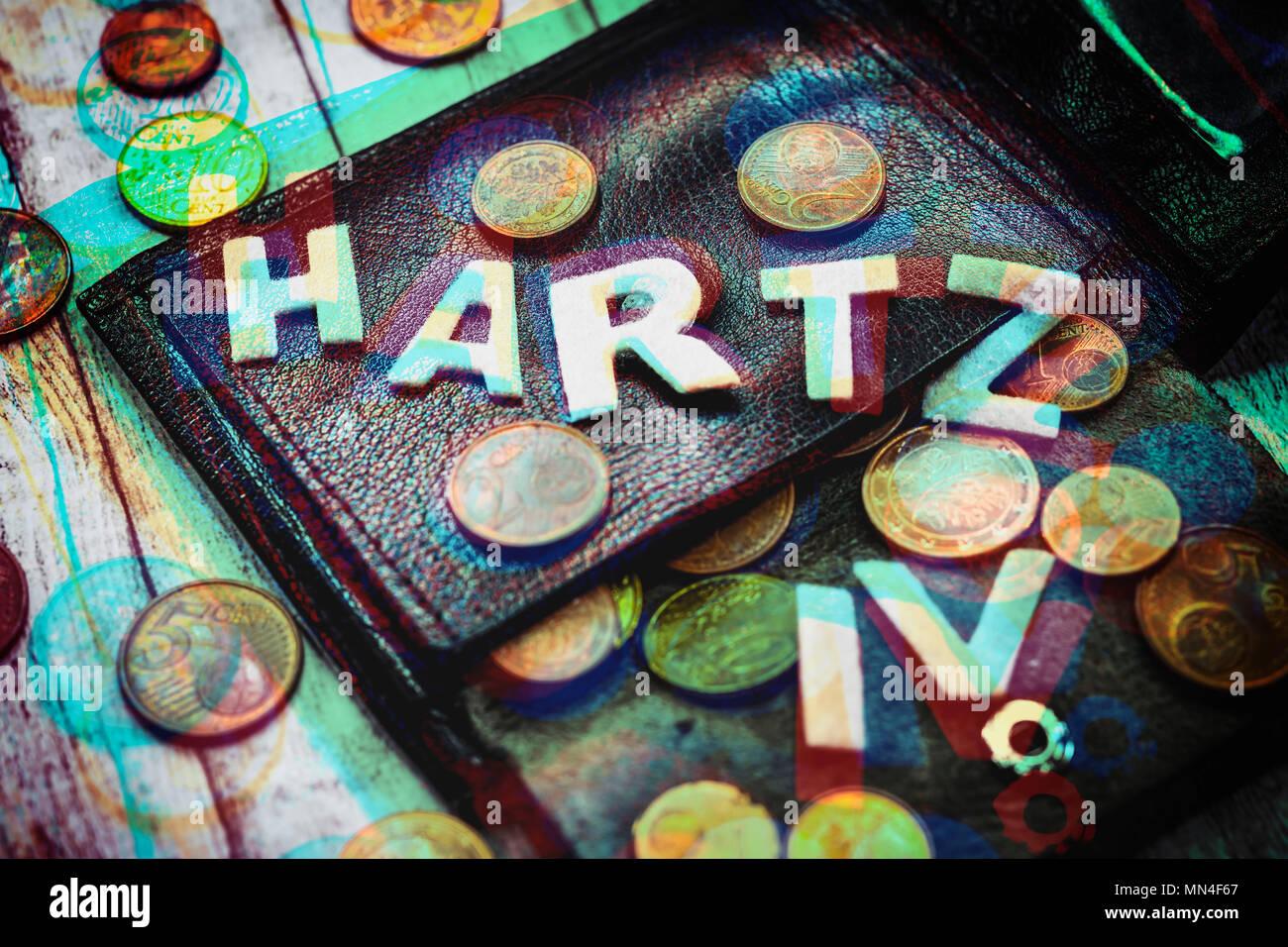 Wallet with small money and lettering Hartz IV, Portemonnaie mit Kleingeld und Schriftzug Hartz IV - Stock Image