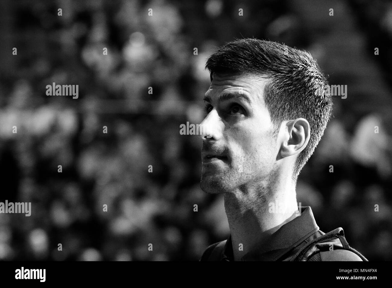 LONDON, ENGLAND - NOVEMBER 17: (Editors Note: Image Converted to Black and White) Novak Djokovic of Serbia leaving the court after victory in his men's singles match against David Goffin of Belgium on day five of the ATP World Tour Finals at the O2 Arena on November 17, 2016 in London, England. - Stock Image