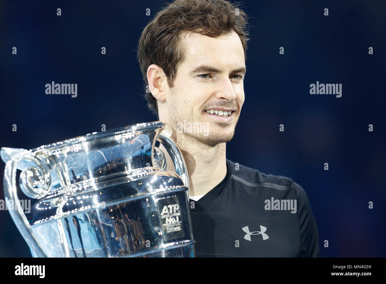 LONDON, ENGLAND - NOVEMBER 20: Andy Murray of Great Britain celebrates with the ATP Tour Trophy after winning the singles tournament against Novak Djokovic of Serbia on Finals day eight of the ATP World Tour Finals at the O2 Arena on November 20, 2016 in London, England. - Stock Image