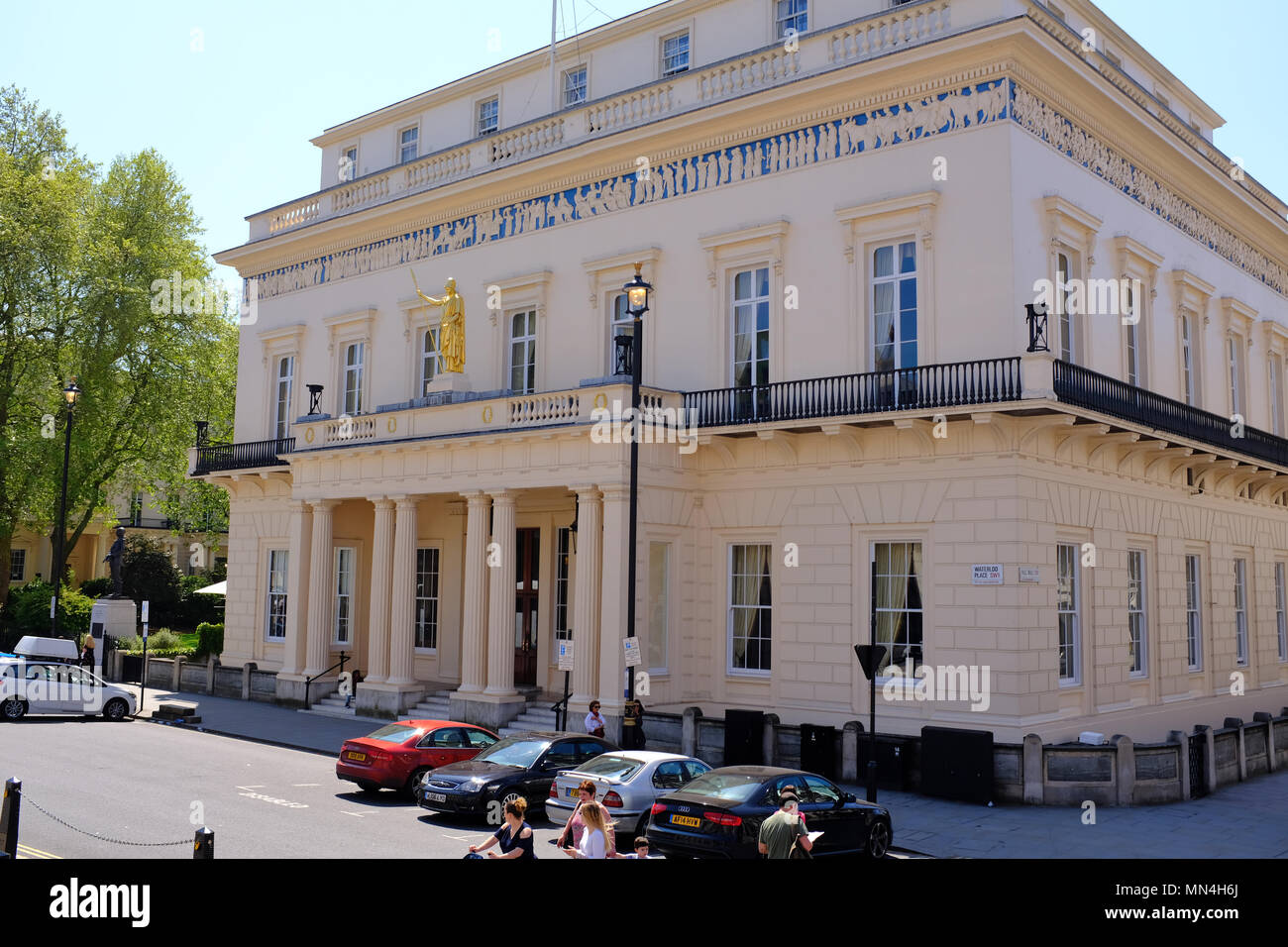 The Athenaeum is a private members' club in London, founded in 1824. It was designed by Decimus Burton in the Neoclassical style with a Doric portico, - Stock Image