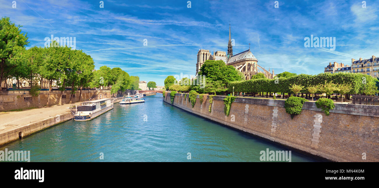 Notre Dame Cathedral in Paris in Spring from the bridge called 'Pont de l'Archeveche', panoramic image - Stock Image