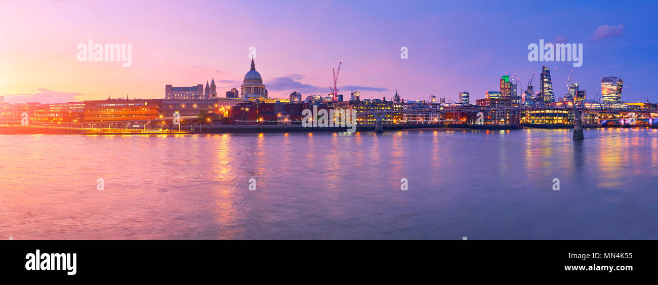 Millennium Bridge leading to Saint Paul's Cathedral in central London, England, on a sunset - Stock Image