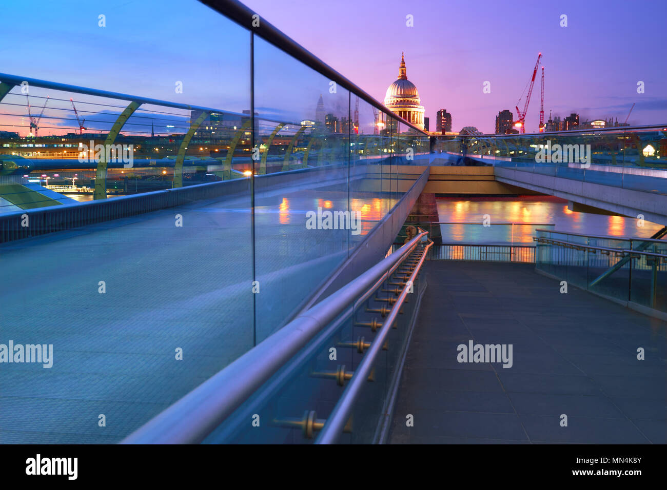Millennium Bridge leading to Saint Paul's Cathedral in central London at sunset Stock Photo
