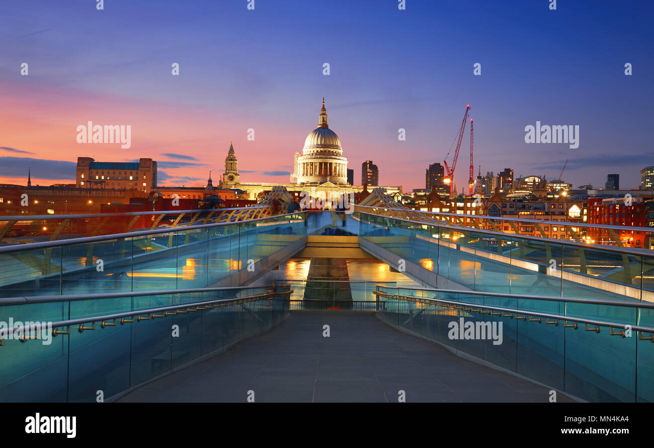 Millennium Bridge leading to Saint Paul's Cathedral in central London at sunset - Stock Image
