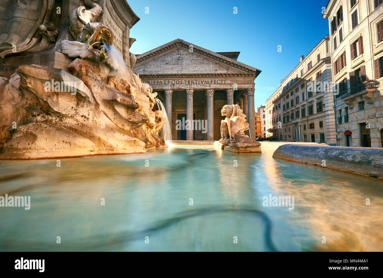 Fountain on Piazza della Rotonda with Parthenon behind on a bright morning in Rome, Italy - Stock Image