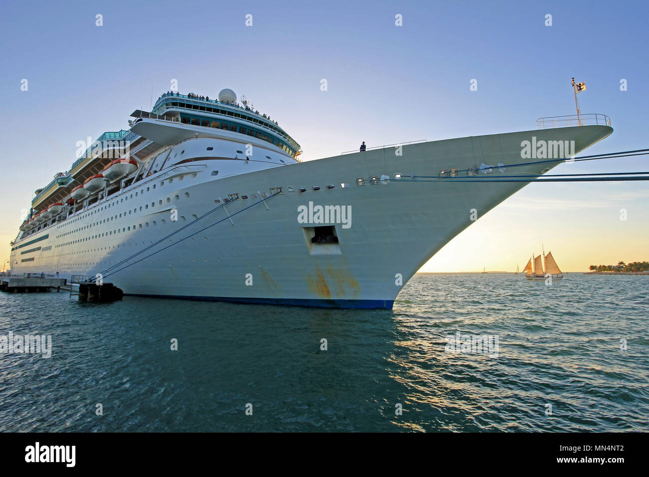 Big cruise ship and small sailing boat, size comparison, Key West