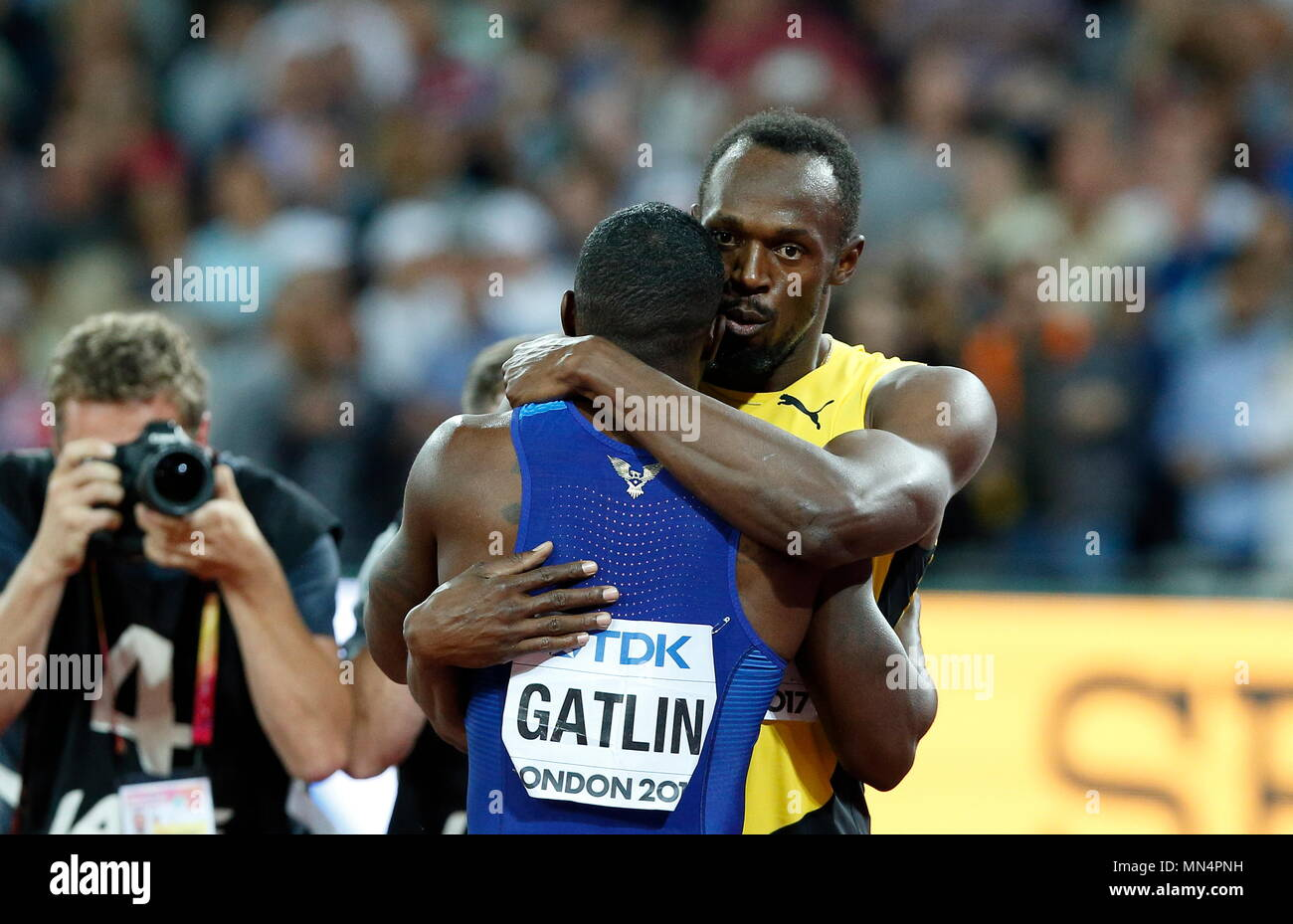 LONDON, ENGLAND - AUGUST 05: Usain Bolt having run his last 100m race embraces the winner of the Mens 100m Final Justin Gatlin during day two of the 16th IAAF World Athletics Championships London 2017 at The London Stadium on August 5, 2017 in London, United Kingdom. Photo by Paul Cunningham - Stock Image