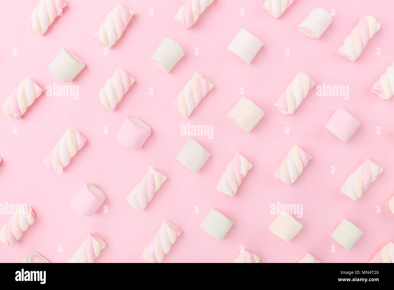 Different pastel color marshmallows on pink pastel background with copy space. Top View. Conceptual Food Trend Flat Lay Stock Photo