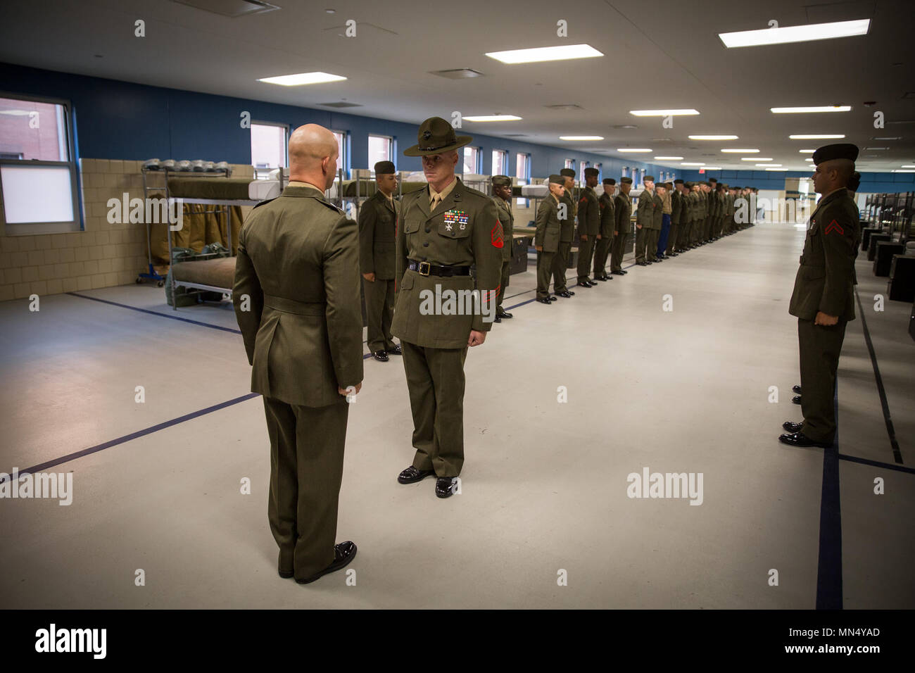 U.S. Marine Corps Sgt. Charles J. Dunphy, senior drill instructor of Platoon 3060, India Company, 3rd Recruit Training Battalion, reports that his Marines are ready for inspection Aug. 23, 2017, on Parris Island, S.C. Formal inspections held by officers and sergeants, like Dunphy, 29, from Philadelphia, ensure Marines have properly fitted uniforms as well as possess attention to detail, bearing, confidence and discipline. India Company is scheduled to graduate Aug. 25, 2017. Parris Island has been the site of Marine Corps recruit training since Nov. 1, 1915. Today, approximately 20,000 recruit - Stock Image