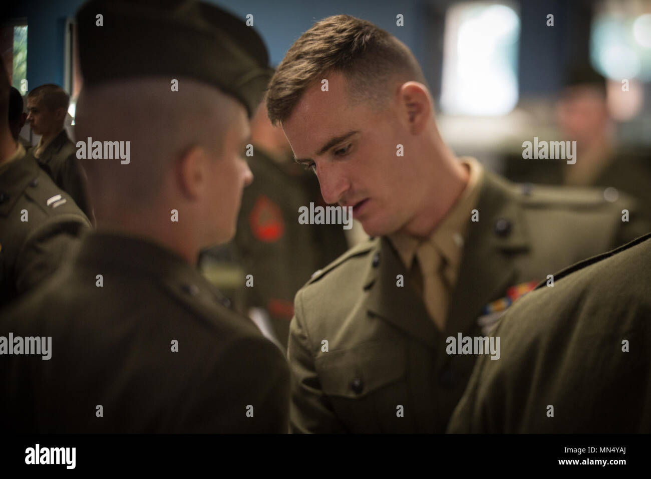 U.S. Marine Corps 1st Lt. Kyle Kavanagh, an assistant series commander of Mike Company, 3rd Recruit Training Battalion, inspects a Marine's uniform Aug. 23, 2017, on Parris Island, S.C. Formal inspections held by sergeants and officers, like Kavanagh, 26, from Valhalla, N.Y., ensure Marines have properly fitted uniforms as well as possess attention to detail, bearing, confidence and discipline. India Company is scheduled to graduate Aug. 25, 2017. Parris Island has been the site of Marine Corps recruit training since Nov. 1, 1915. Today, approximately 20,000 recruits come to Parris Island annu - Stock Image