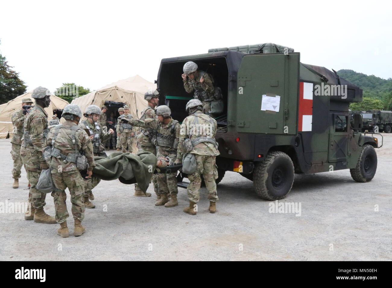 The 65th Medical Brigade Team Transports A Casualty During Combined Joint MEDEVAC Exercise Aug 30 At Hongcheon