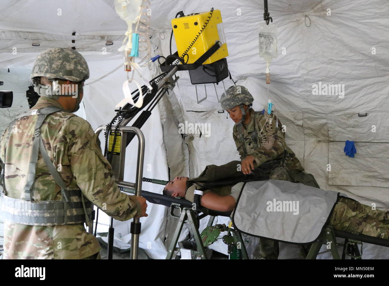 The 65th Medical Brigade Team Conducts X Rays On A Casualty With Broken Arm During Combined Joint MEDEVAC Exercise Dragon Lift Aug