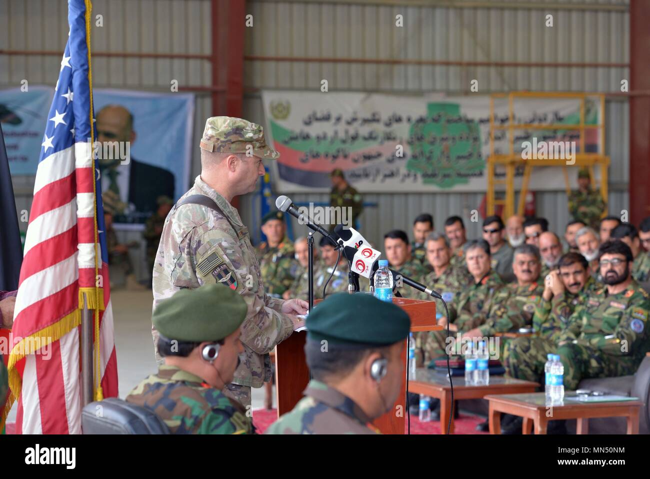 KANDAHAR AIRFIELD (May 8,2018) -- U.S. Air Force Brig. Gen. Phillip Stewart, Train, Advise, Assist Command-Air commander, addresses graduates from the first Afghan UH-60 Mission Qualification Training course at a ceremony in their honor May 8, 2018, Kandahar Air base, Afghanistan. The 31 graduates represent a generational shift from the older soviet-trained forces to a younger and more progressive western-trained and educated fleet. (U.S. Air Force photo/1st Lt. Erin Recanzone) - Stock Image
