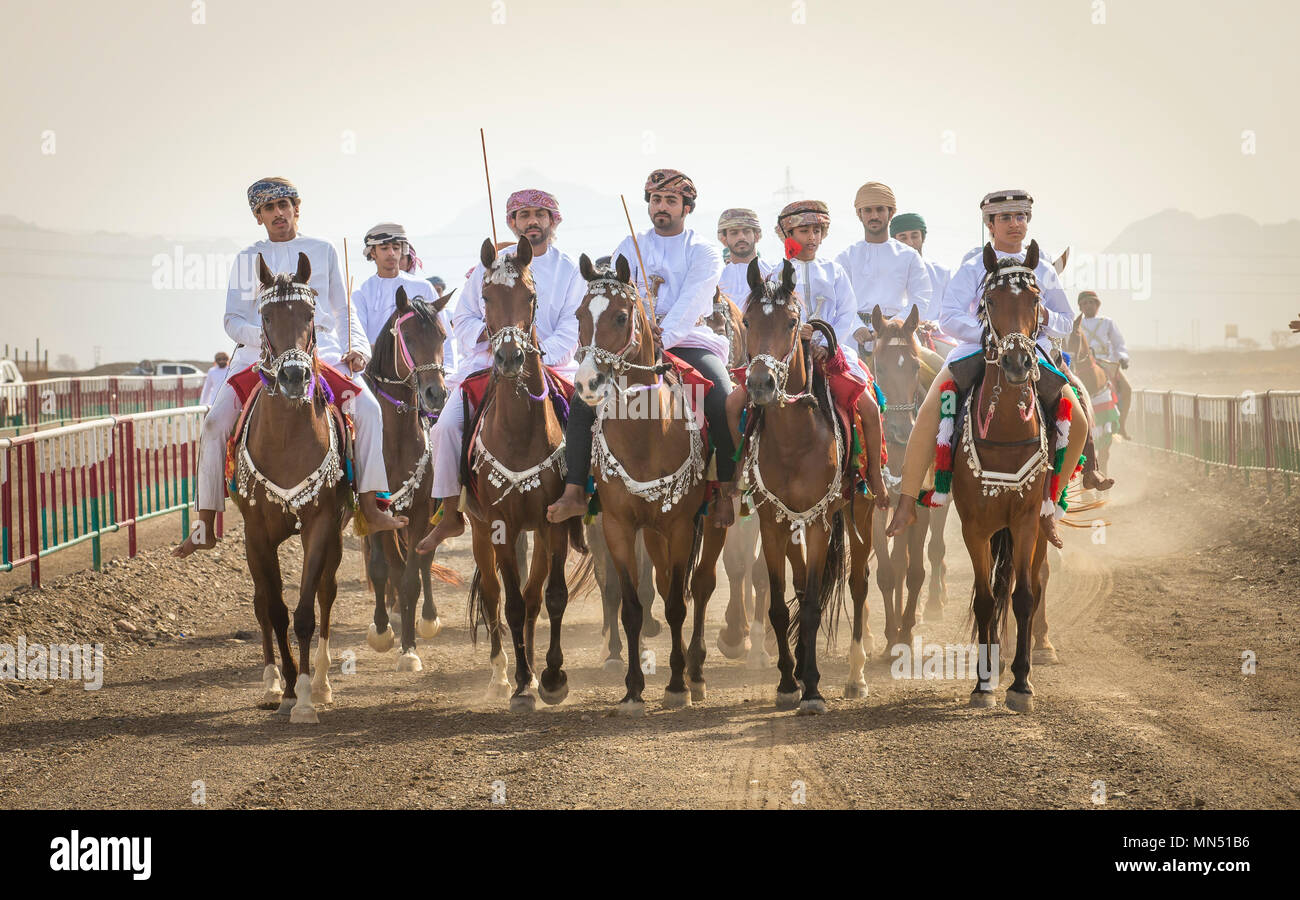 Ibri, Oman, 28th April 2018: omani men arriving at a horse race at a countryside Stock Photo