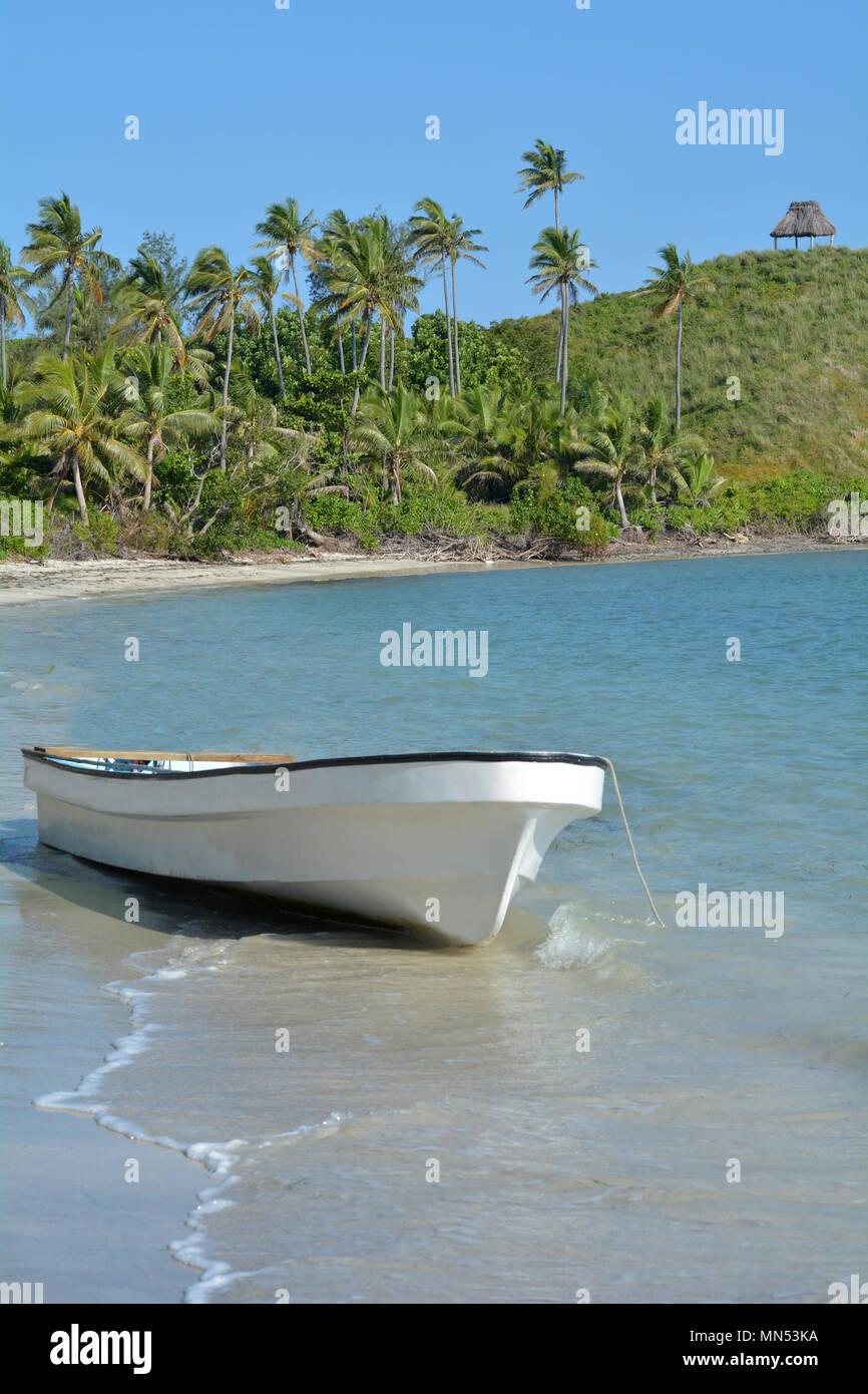 White Fishing Boat On A Tropical Island In The Yasawa Islands Group Fiji