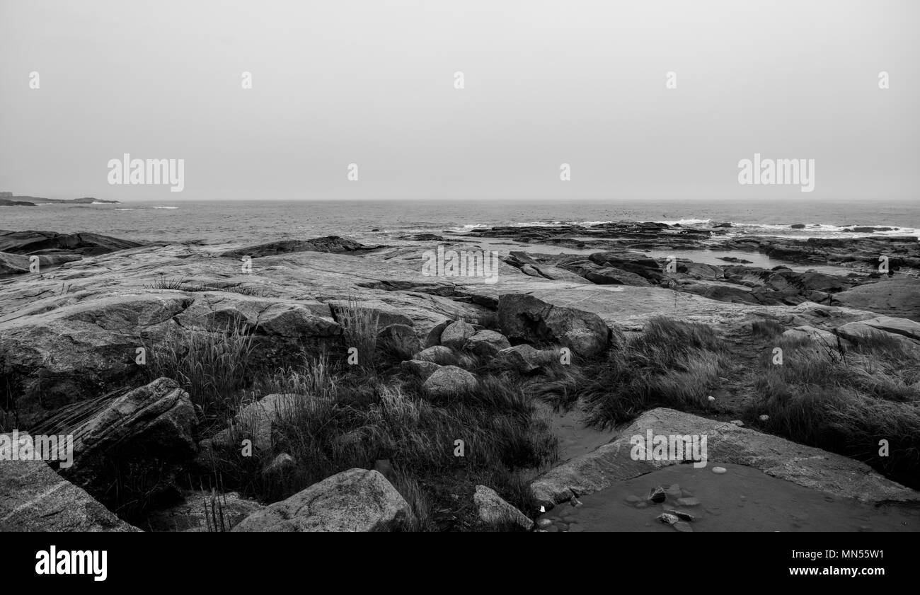 The coast of Maine on and overcast day in black & white. - Stock Image
