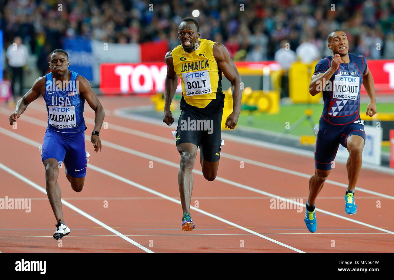 LONDON, ENGLAND - AUGUST 05: Usain Bolt of Jamaica  running in lane 4 of the Mens 100m Final competing with Christian Coleman of the USA and Jimmy Vicaut of France during day two of the 16th IAAF World Athletics Championships London 2017 at The London Stadium on August 5, 2017 in London, United Kingdom. Photo by Paul Cunningham - Stock Image
