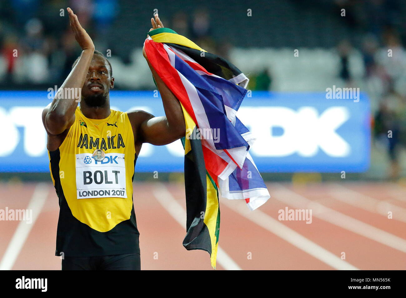 LONDON, ENGLAND - AUGUST 05: Usain Bolt of Jamaica having run his last 100m race, applauds the crowd during a lap of honour during day two of the 16th IAAF World Athletics Championships London 2017 at The London Stadium on August 5, 2017 in London, United Kingdom. Photo by Paul Cunningham - Stock Image