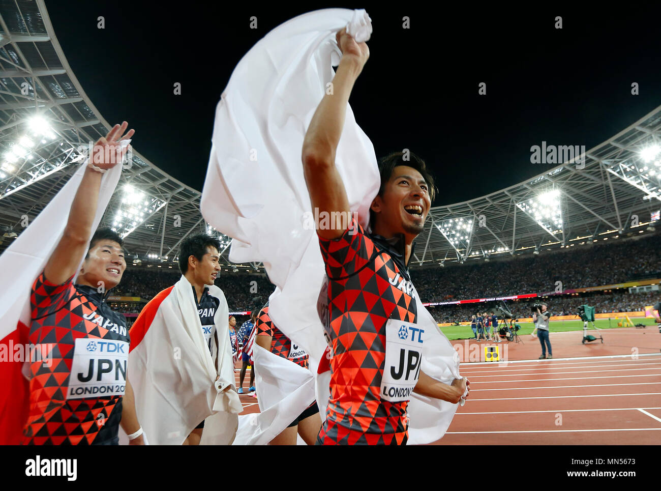 LONDON, ENGLAND - AUGUST 12: Shuhei Tada, Shota Iizuka, Yoshihide Kiryu and Kenji Fujimitsu of Japan celebrate winning bronze in the Men's 4x100 Relay final during day nine of the 16th IAAF World Athletics Championships London 2017 at The London Stadium on August 12, 2017 in London, United Kingdom --- Image by © Paul Cunningham - Stock Image