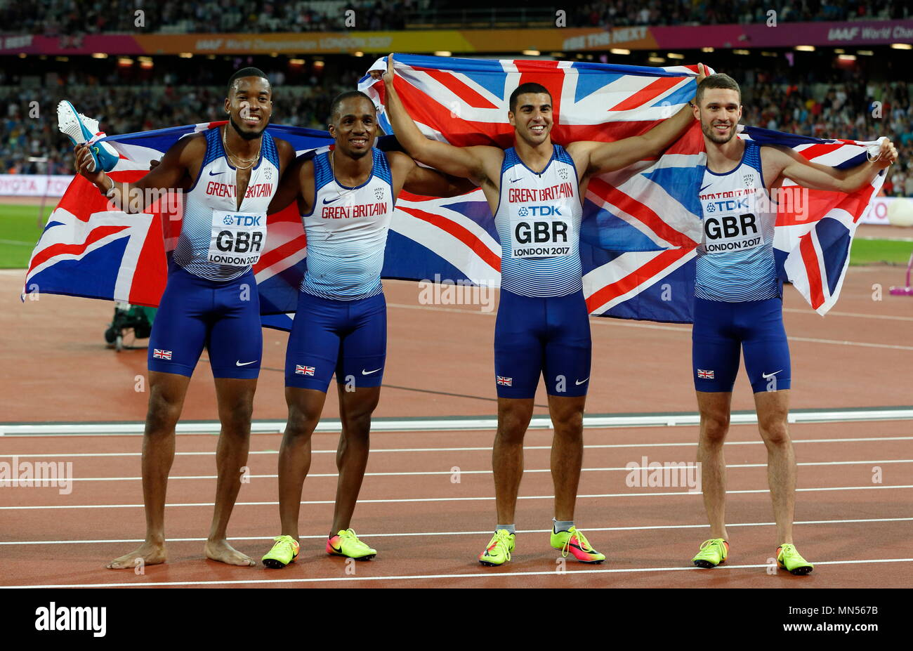 LONDON, ENGLAND - AUGUST 12: Chijindu Ujah, Adam Gemili, Daniel Talbot and Nethaneel Mitchell-Blake of Great Britain celebrate winning gold in the Men's 4x100 Relay final during day nine of the 16th IAAF World Athletics Championships London 2017 at The London Stadium on August 12, 2017 in London, United Kingdom. - Stock Image