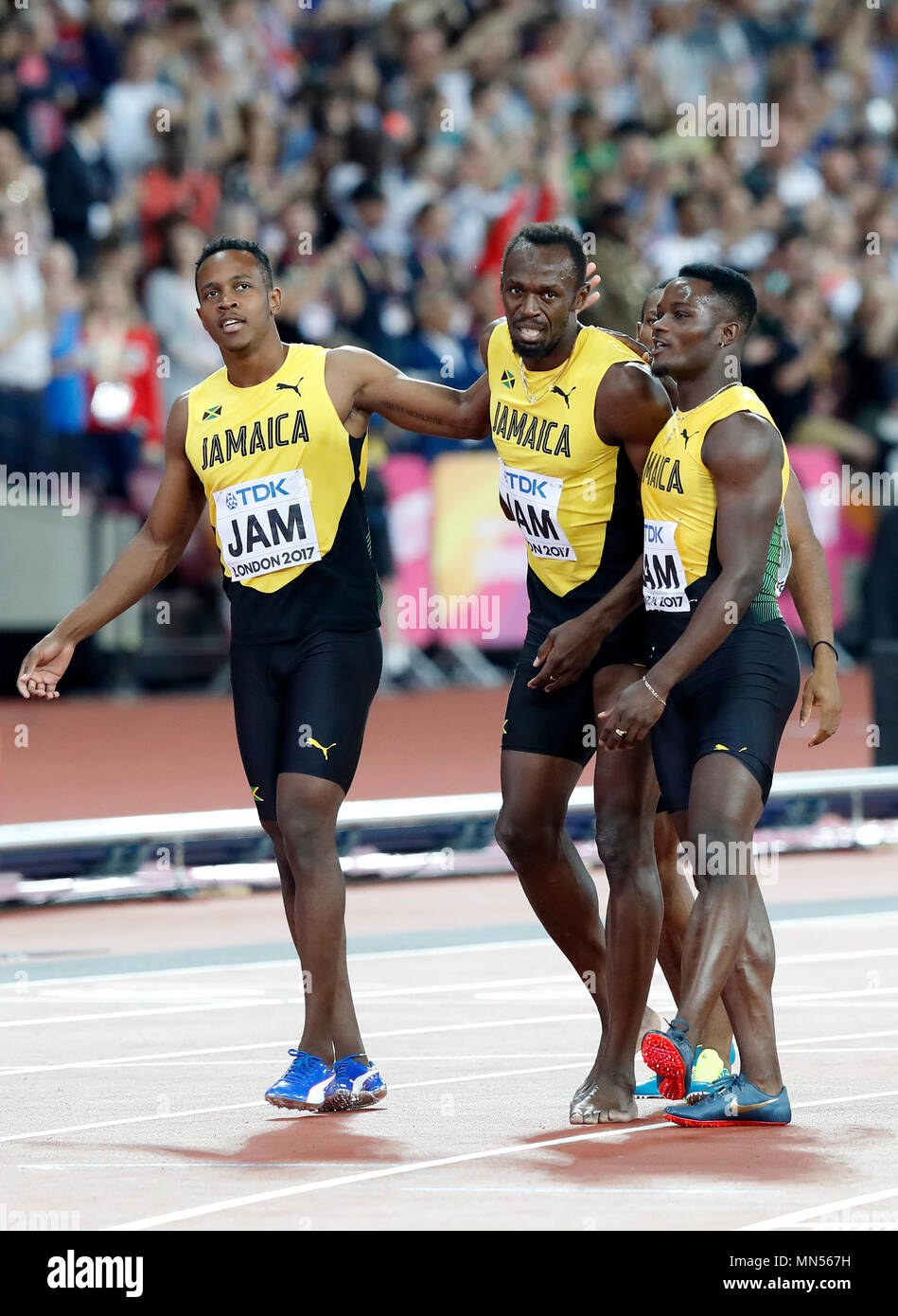 LONDON, ENGLAND - AUGUST 12: Usain Bolt of Jamaica leaving with team mates Tyquendo Tracey, Julian Forte and Michael Campbell after falling in the Men's 4x100 Relay final during day nine of the 16th IAAF World Athletics Championships London 2017 at The London Stadium on August 12, 2017 in London, United Kingdom --- Image by © Paul Cunningham - Stock Image